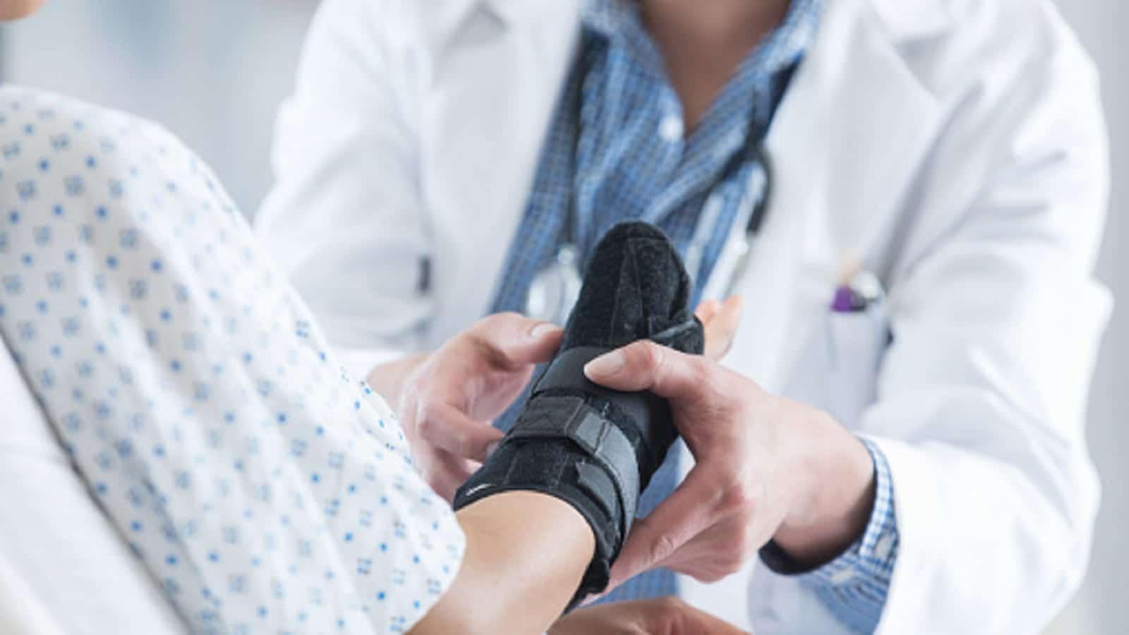 Woman With Wrist Injury Stock Photo