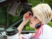 Distracted Female Driver Stock Photo