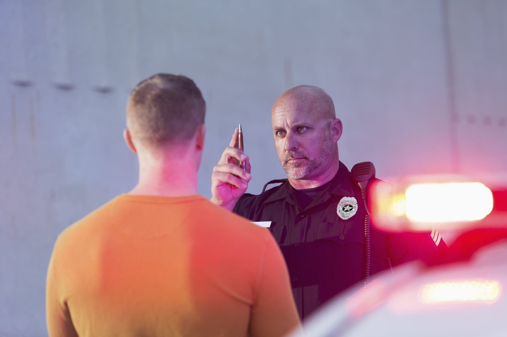 Police Officer Giving Sobriety Test To Drunk Driver Stock Photo