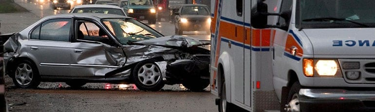 Ambulance Responding To A Car Accident Stock Photo