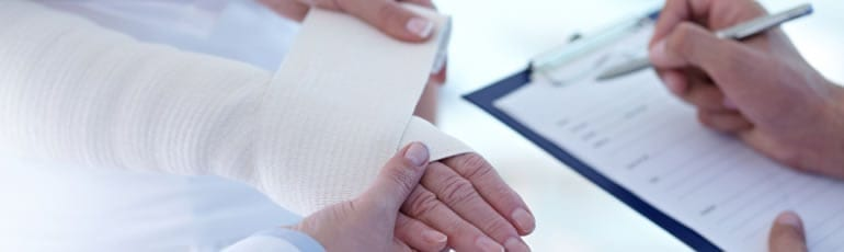 Hand Being Wrapped In A Bandage Stock Photo