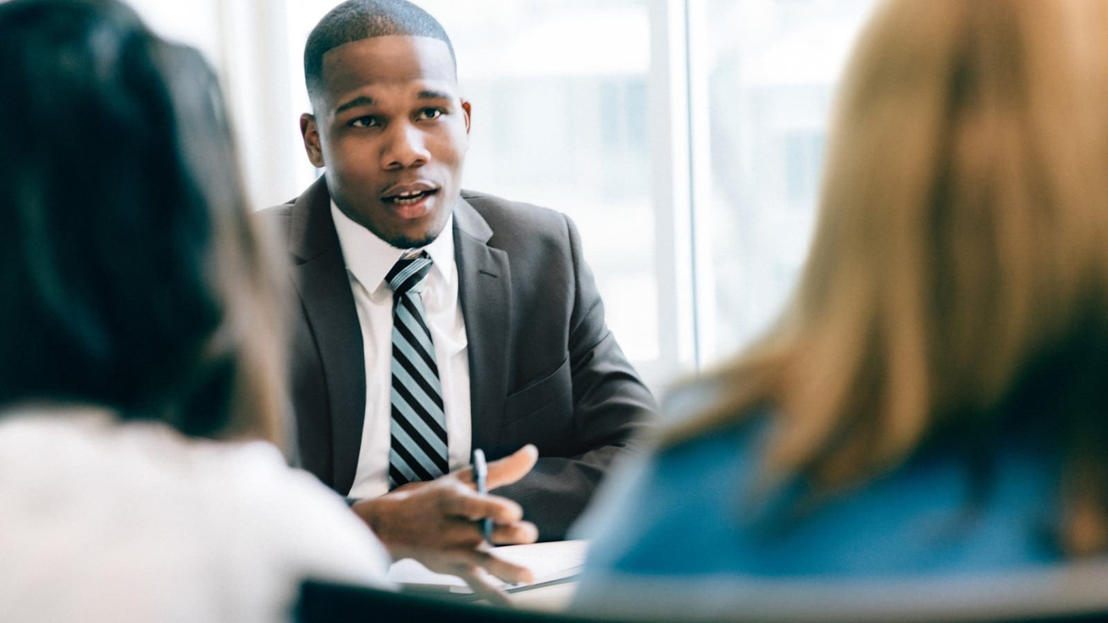 Lawyer Meeting Privately With Clients Stock Photo