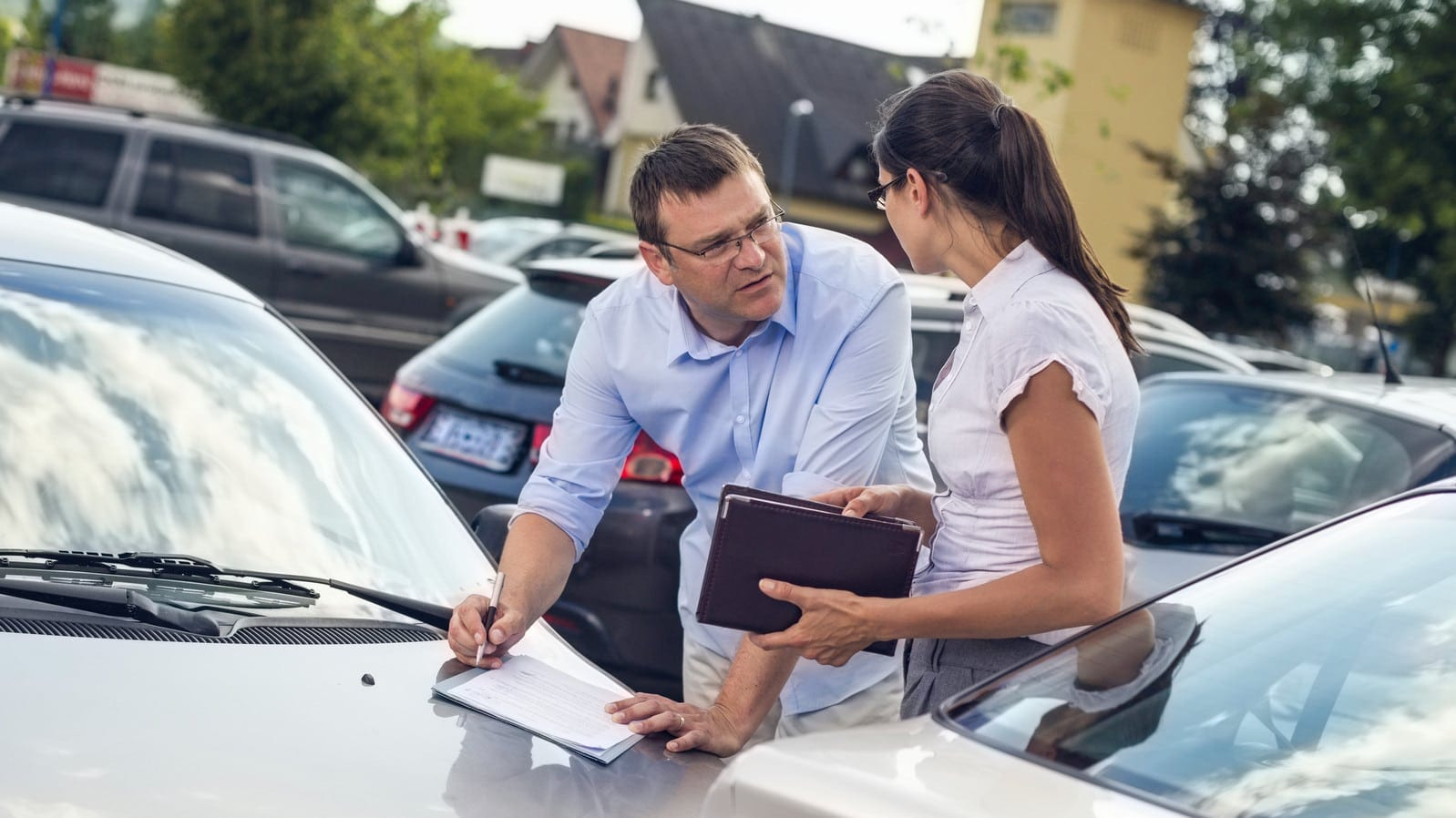 Man and Woman Exchanging Insurance Information Stock Photo