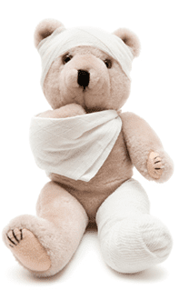 Teddy Bear With Arm and Leg In A Cast Stock Photo