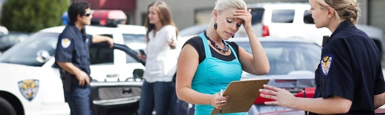 Police Completing Car Accident Report Stock Photo