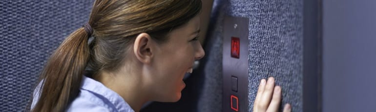 Young Woman Stuck In An Elevator Stock Photo
