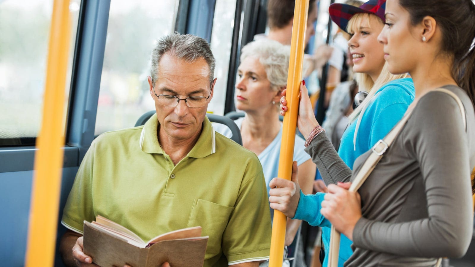 Man Riding Public Transit Stock Photo