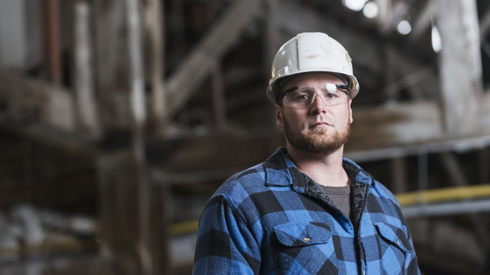 Blue Collar Worker In Hard Hat Stock Photo