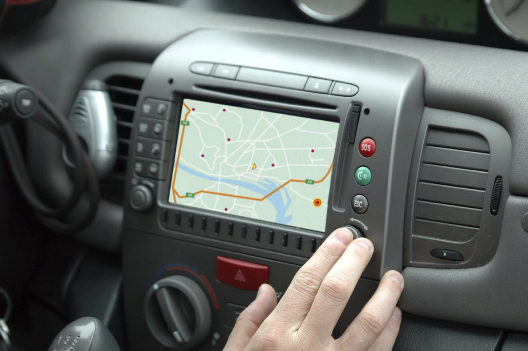 Driver Using GPS System Inside Vehicle Stock Photo