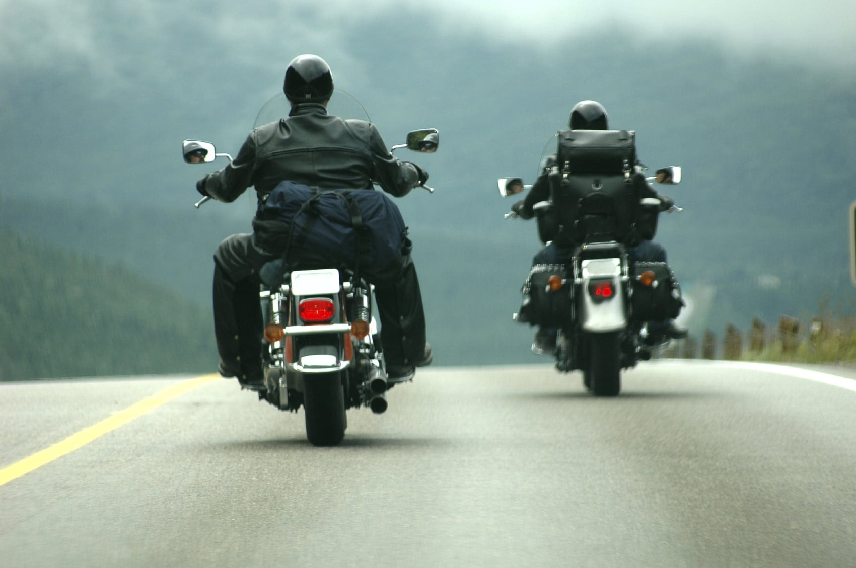 Motorcyclists Riding On A Rural Highway Stock Photo