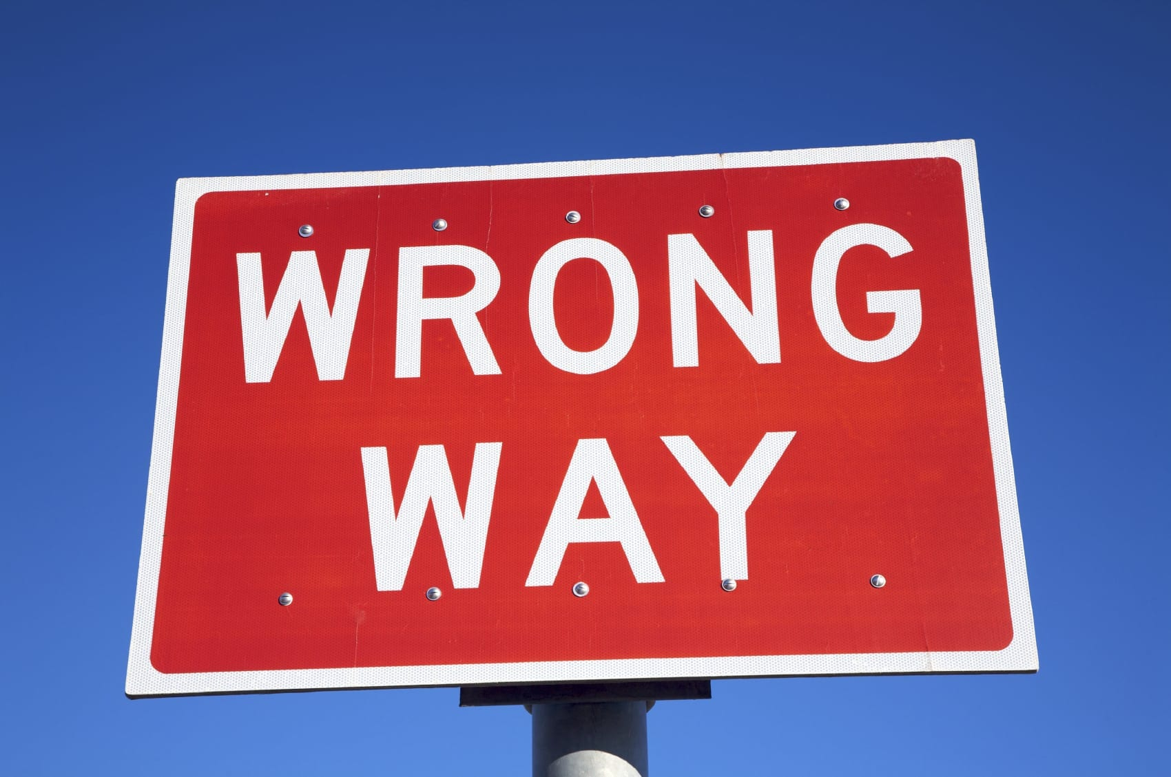 Red Wrong Way Sign Stock Photo