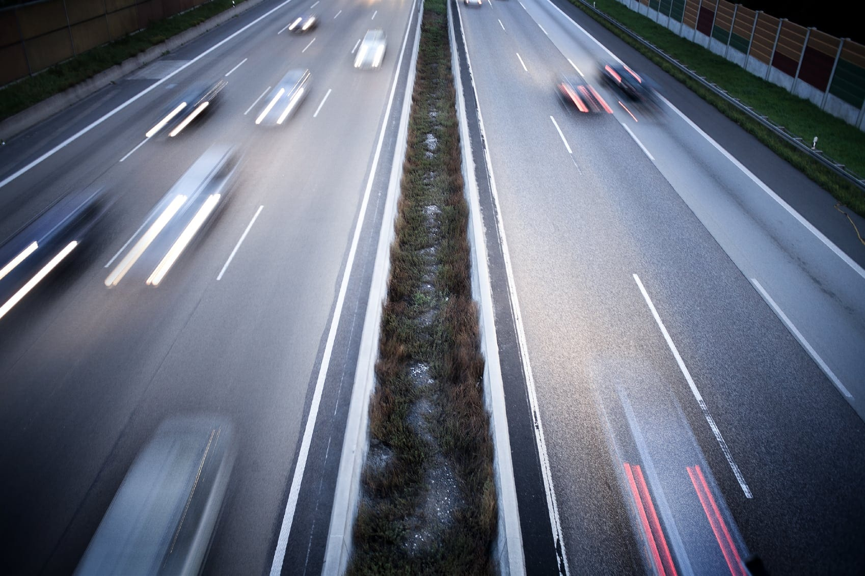 Long Lines Of Cars Driving Fast On The Highway Stock Photo