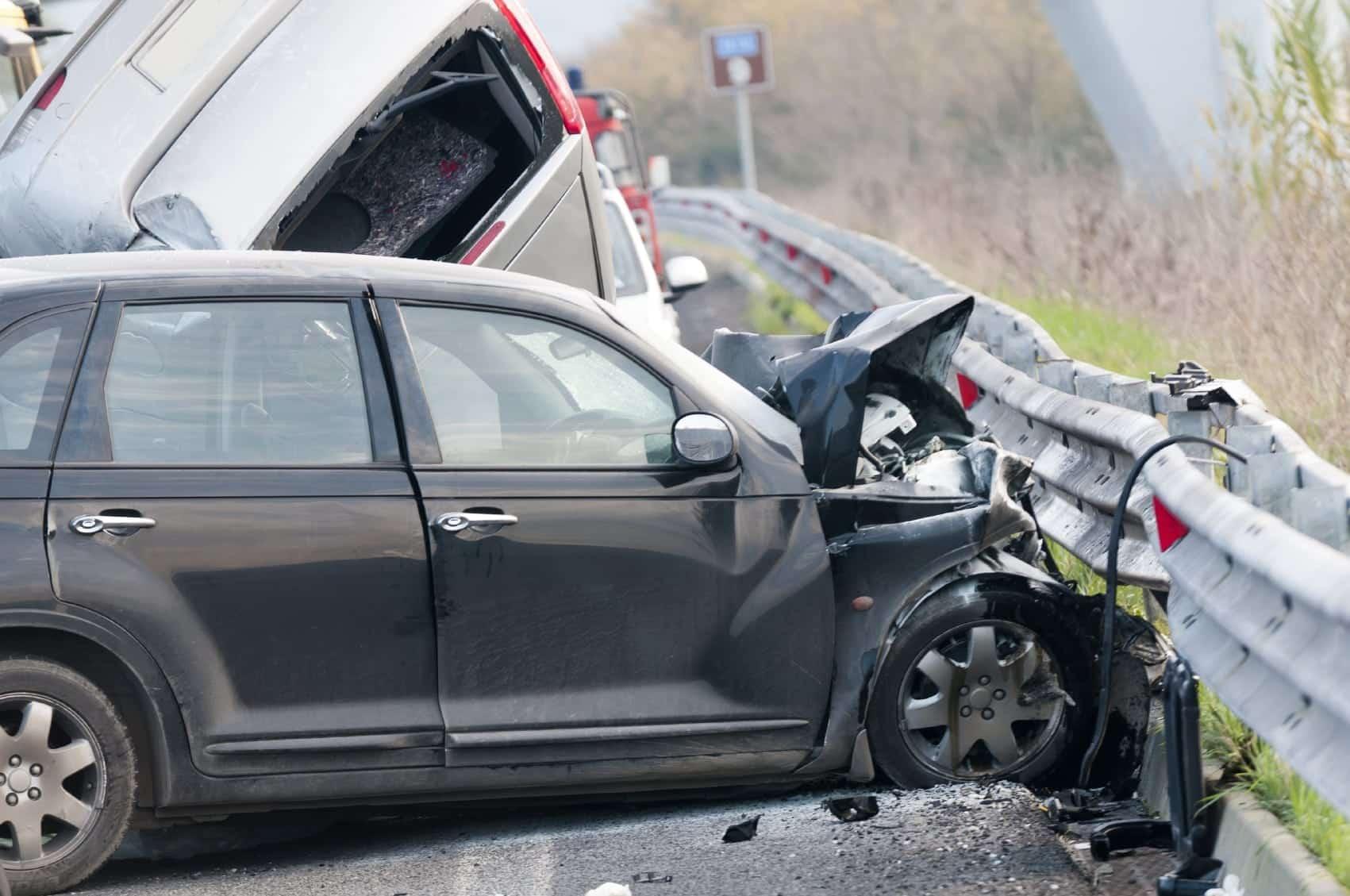 Car Accident Against Guardrail Stock Photo