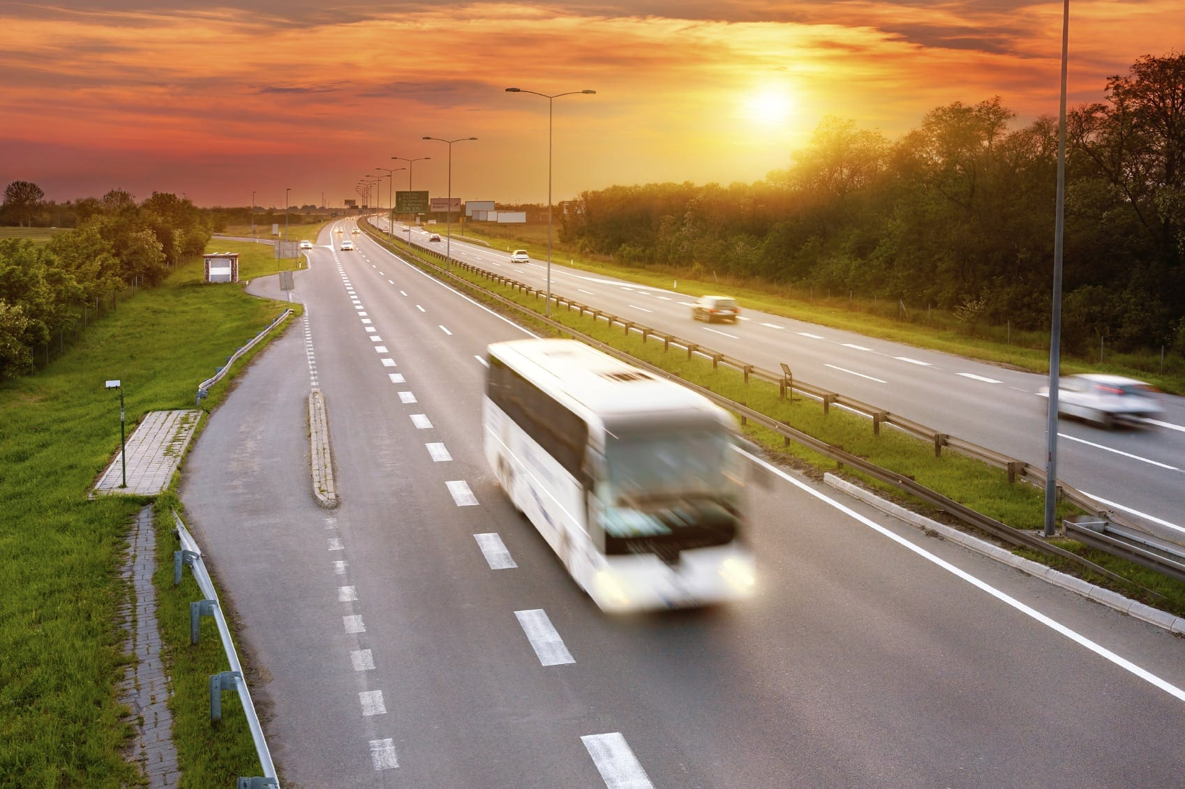 Large Tour Bus Driving On The Interstate Stock Photo