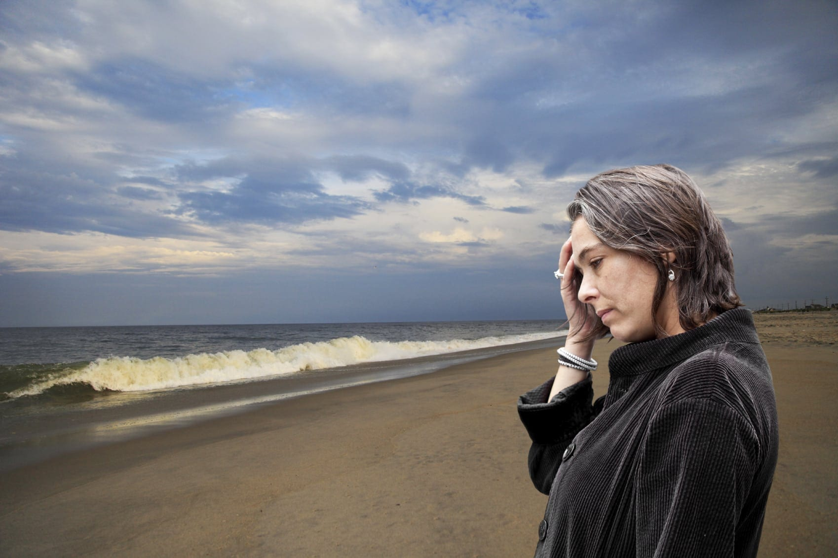 Grieving Woman Walking The Beach Stock Photo