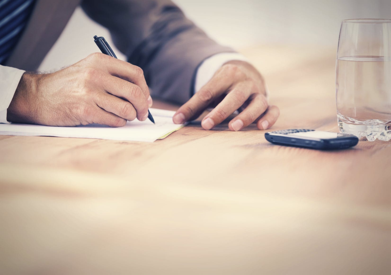 Lawyer Signing Legal Documents Privately Stock Photo