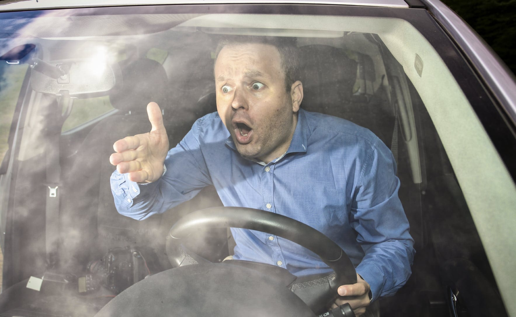 Male Driver Expressing Road Rage Stock Photo