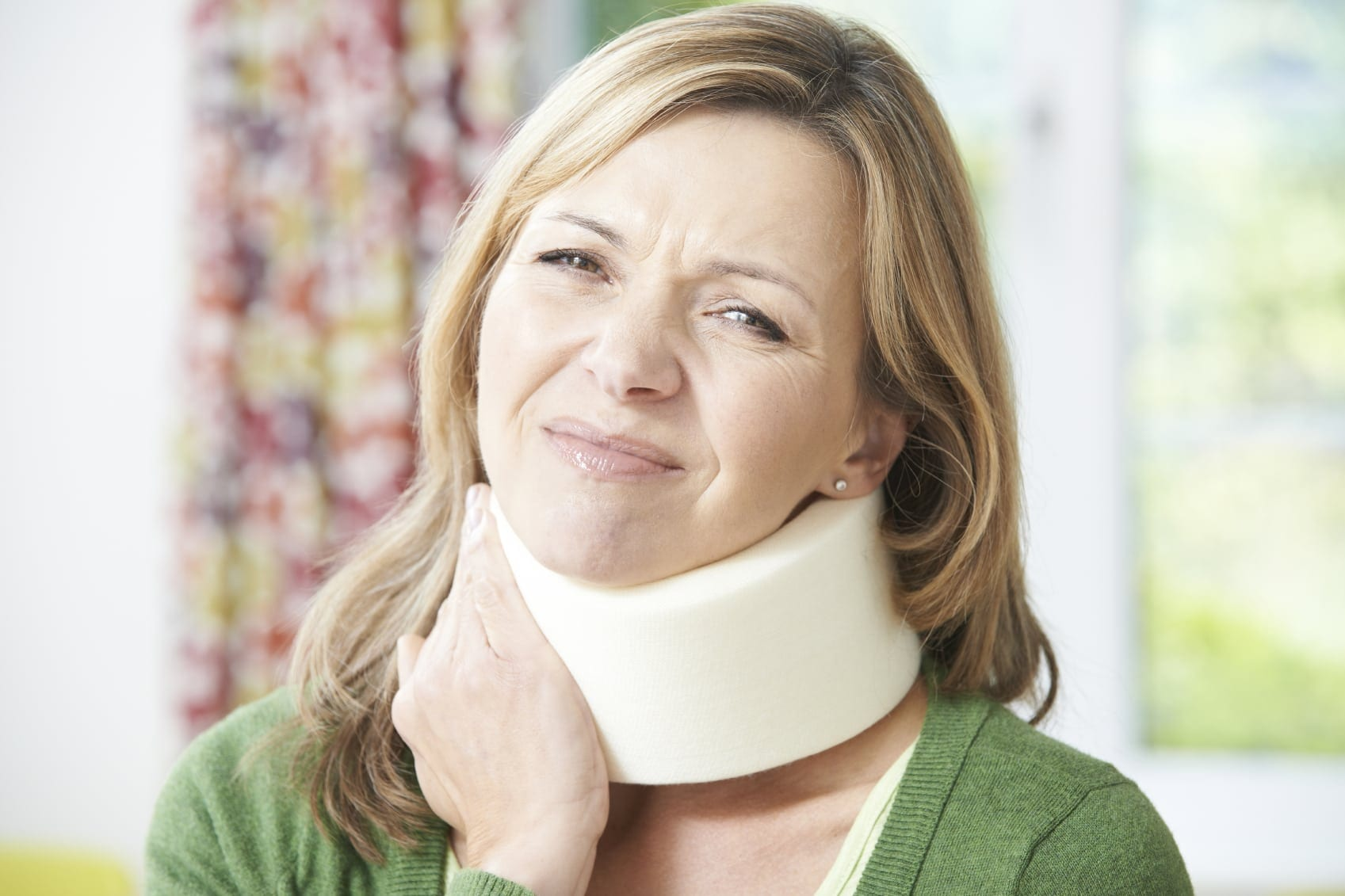 Woman In A Neck Brace Experiencing Neck Pain Stock Photo