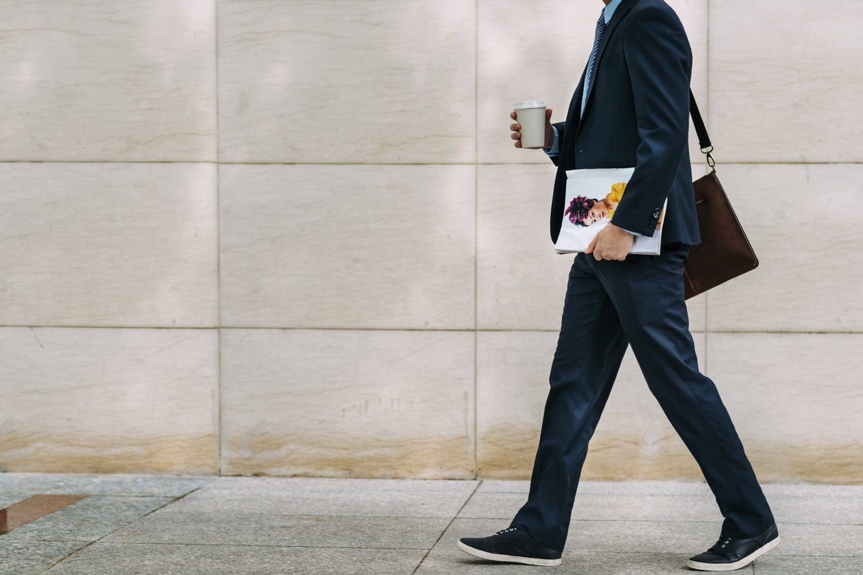 Male Pedestrian Walking Down A City Street Stock Photo