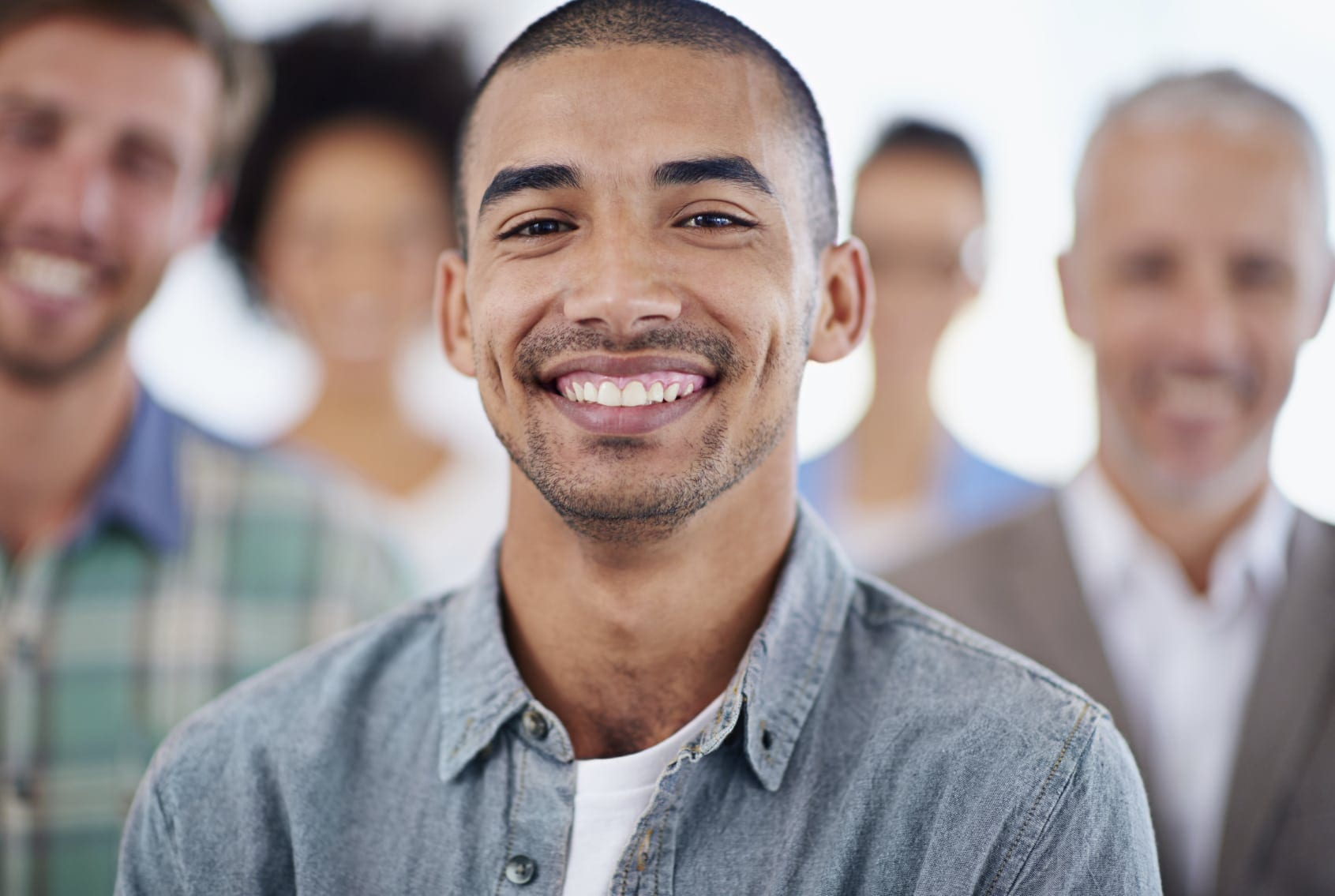Group Of Men Smiling At The Camera Stock Photo