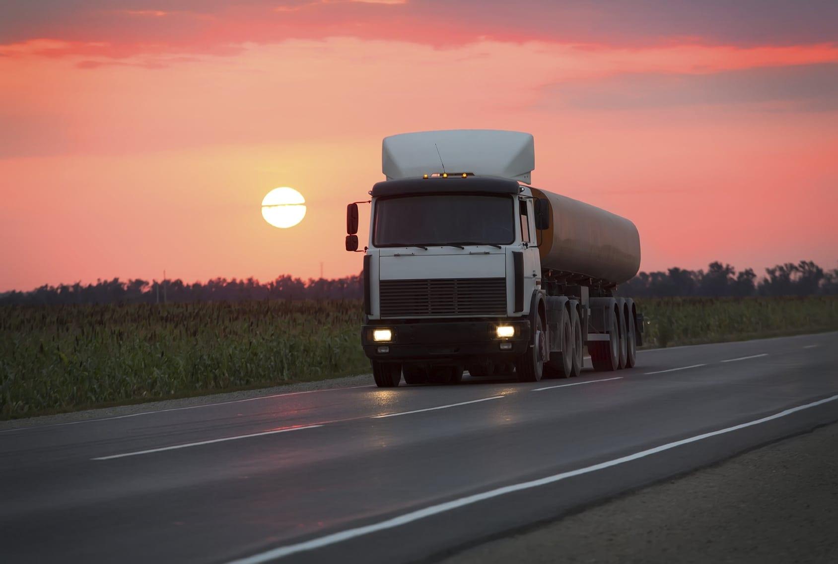 18-wheeler Truck Driving At Dusk Stock Photo