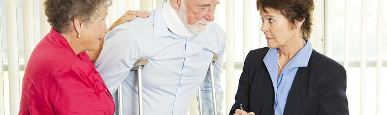 Elderly Man Using Crutches Stock Photo