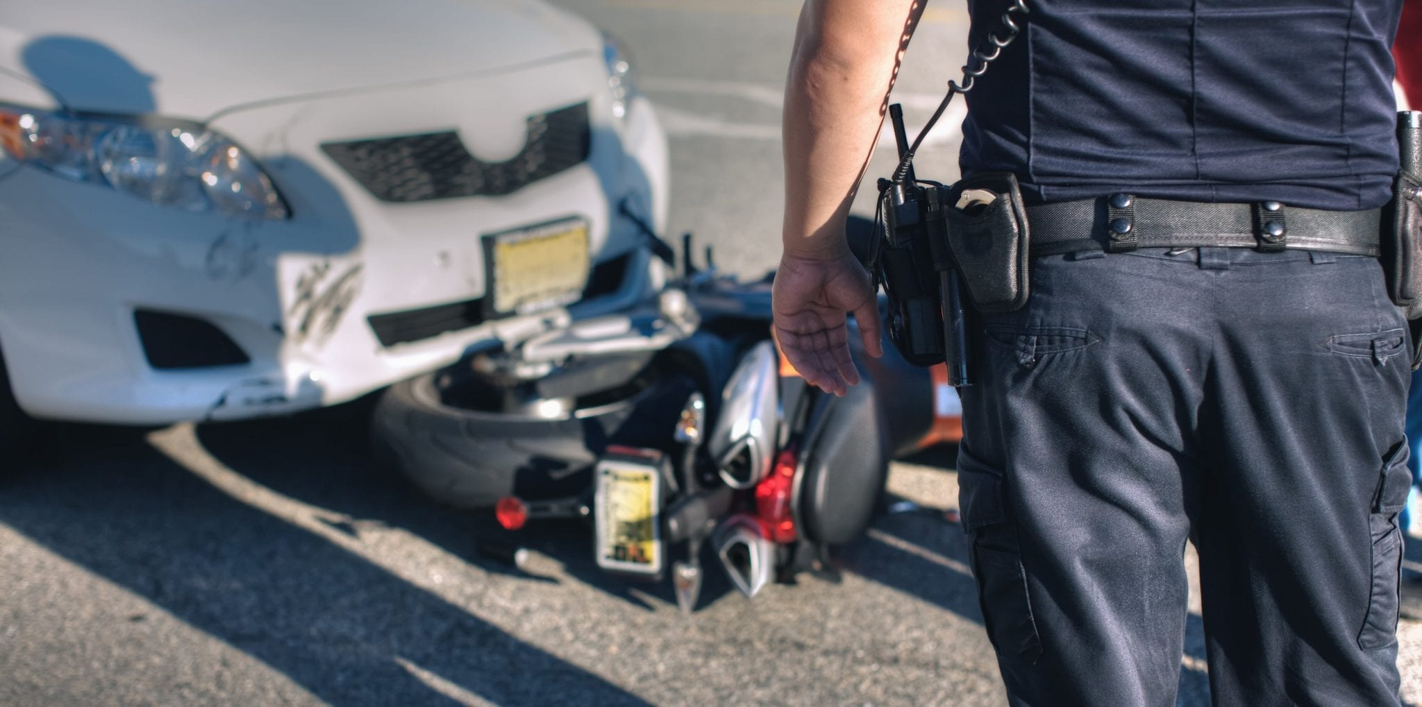 Motorcycle Accident With White Car Stock Photo