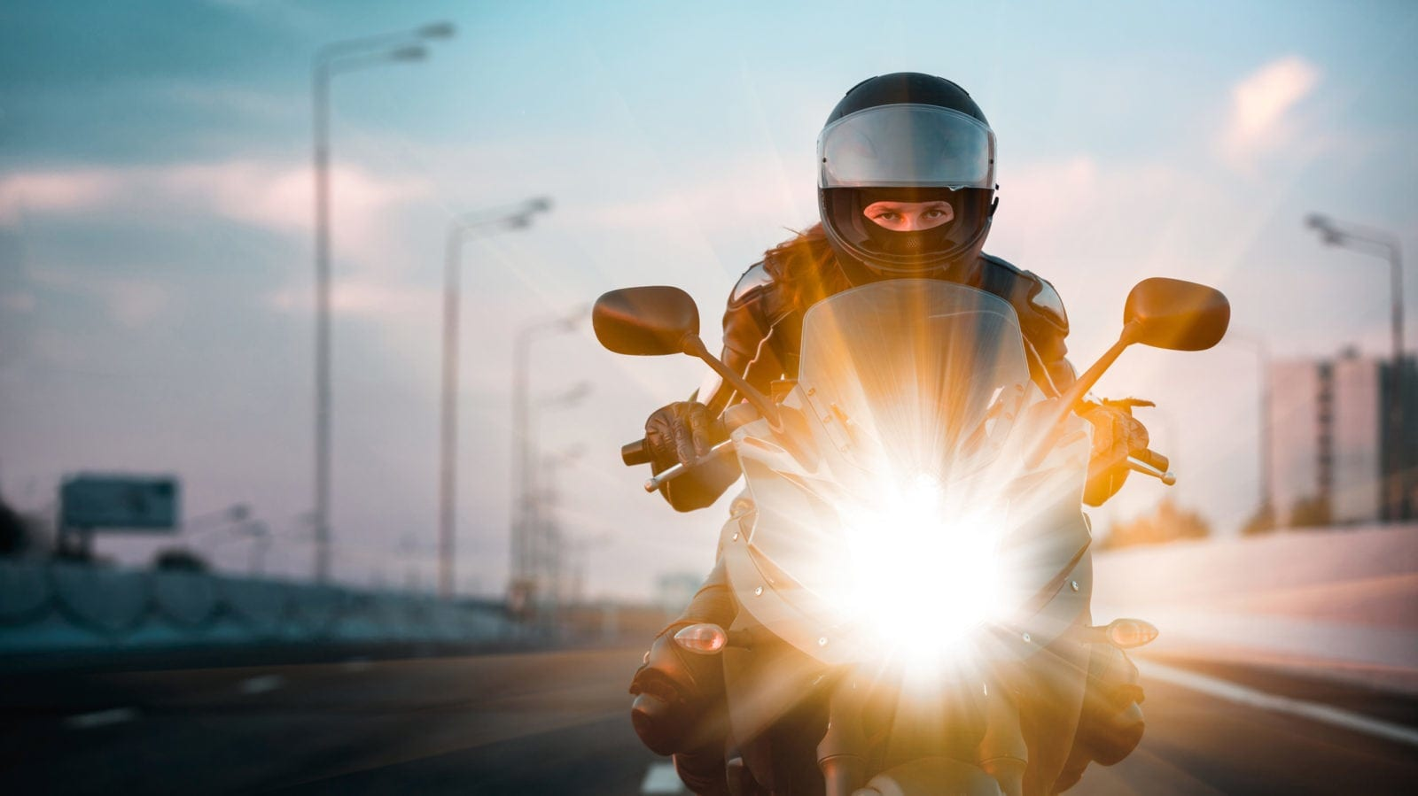 Young Woman Riding A Motorcycle Stock Photo