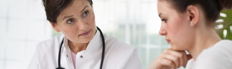 Female Doctor Speaking With Female Patient Stock Photo