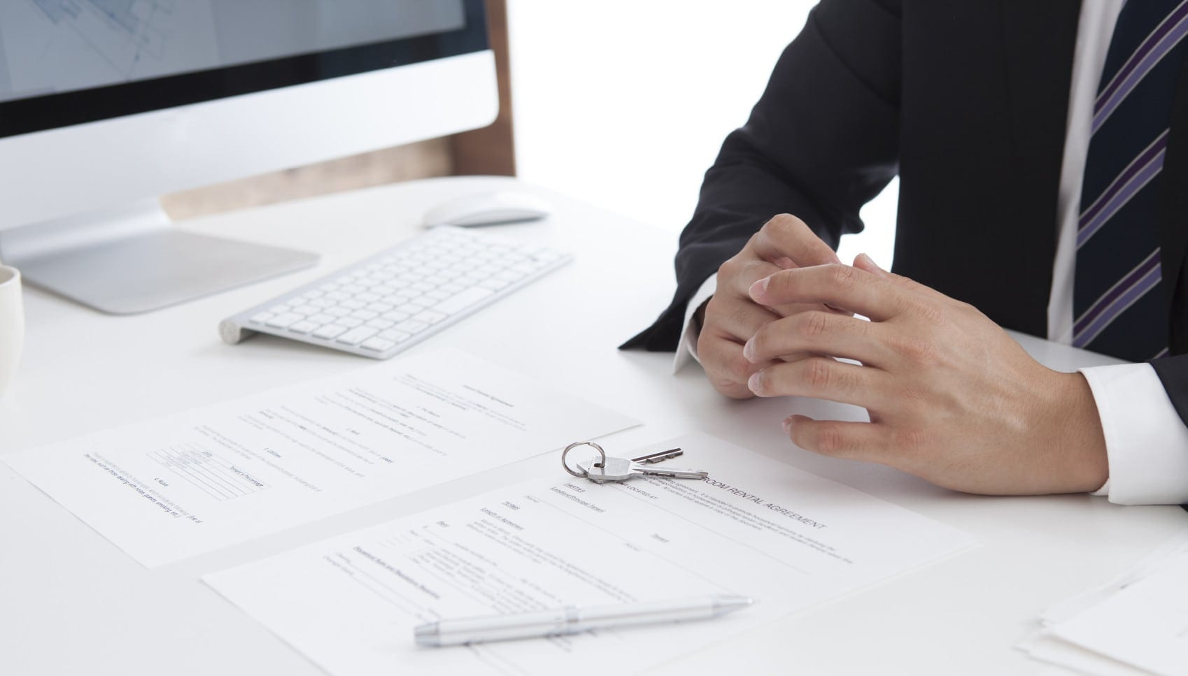Insurance Agent Prompting Someone To Sign A Document