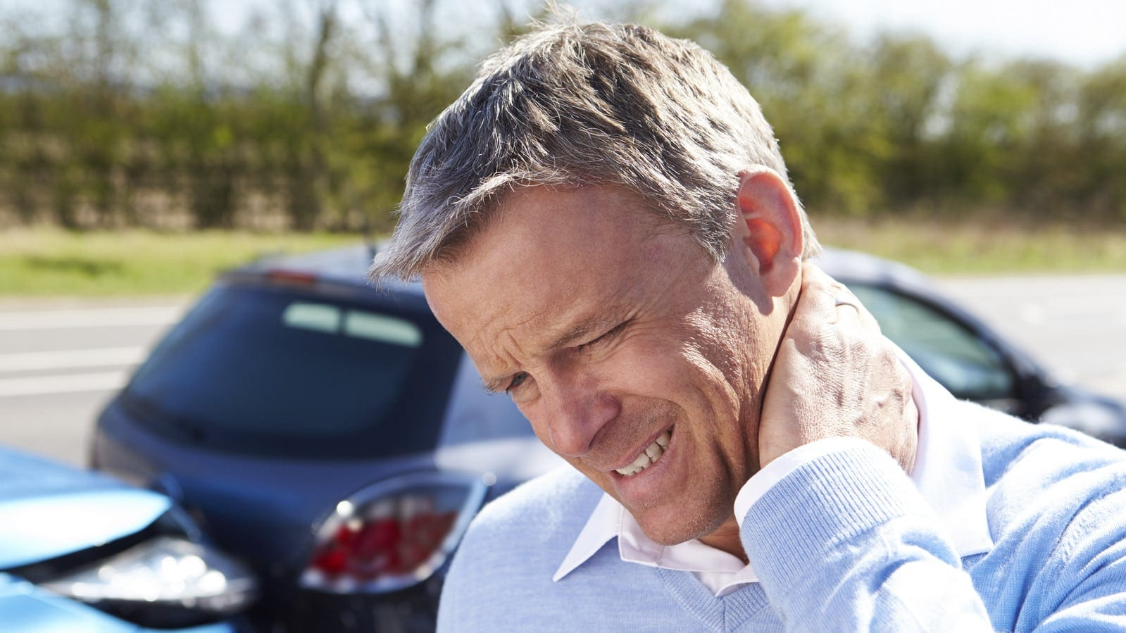 Man With Neck Pain After Rear End Car Accident Stock Photo