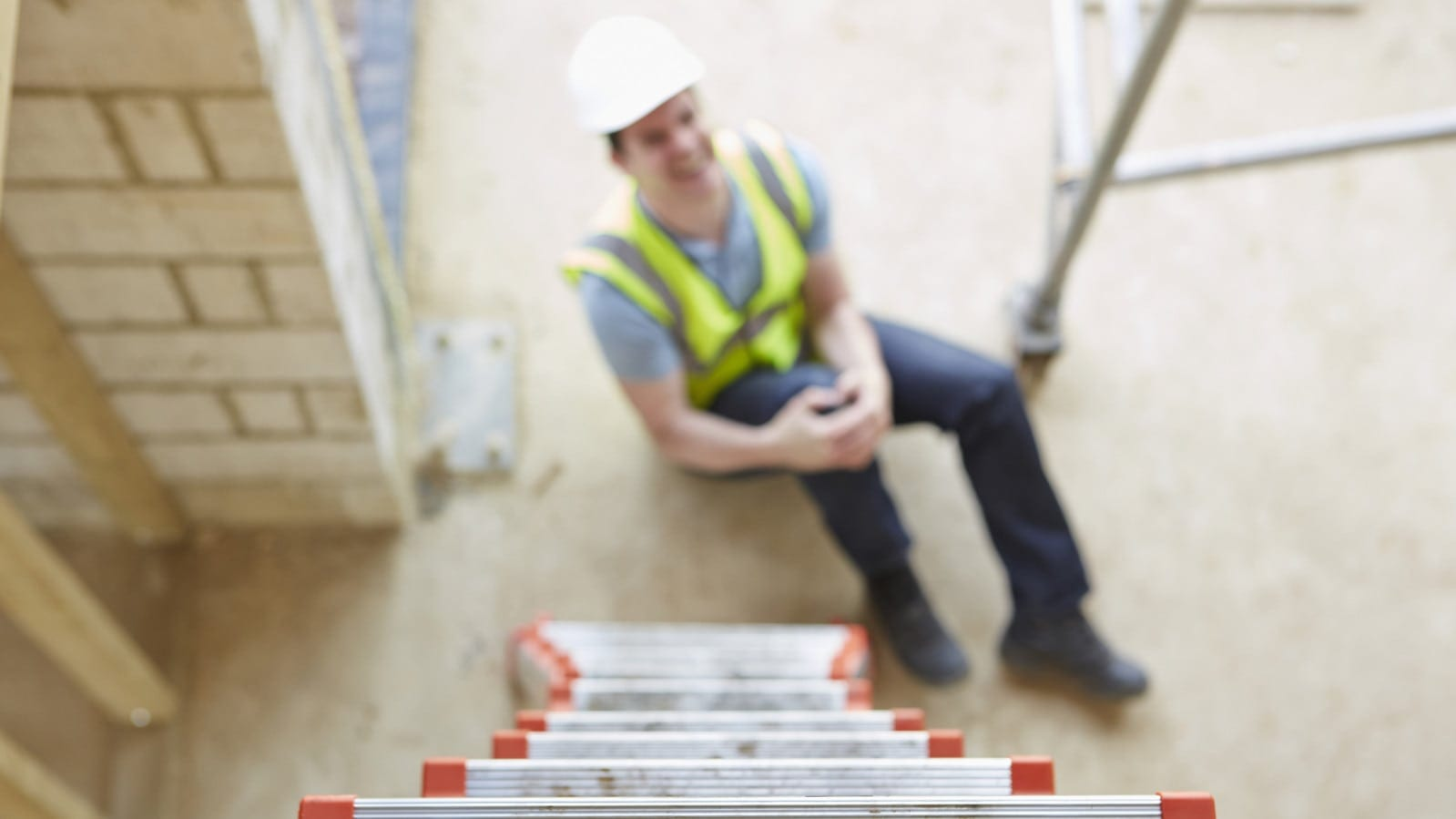Construction Worker With Knee Injury Stock Photo