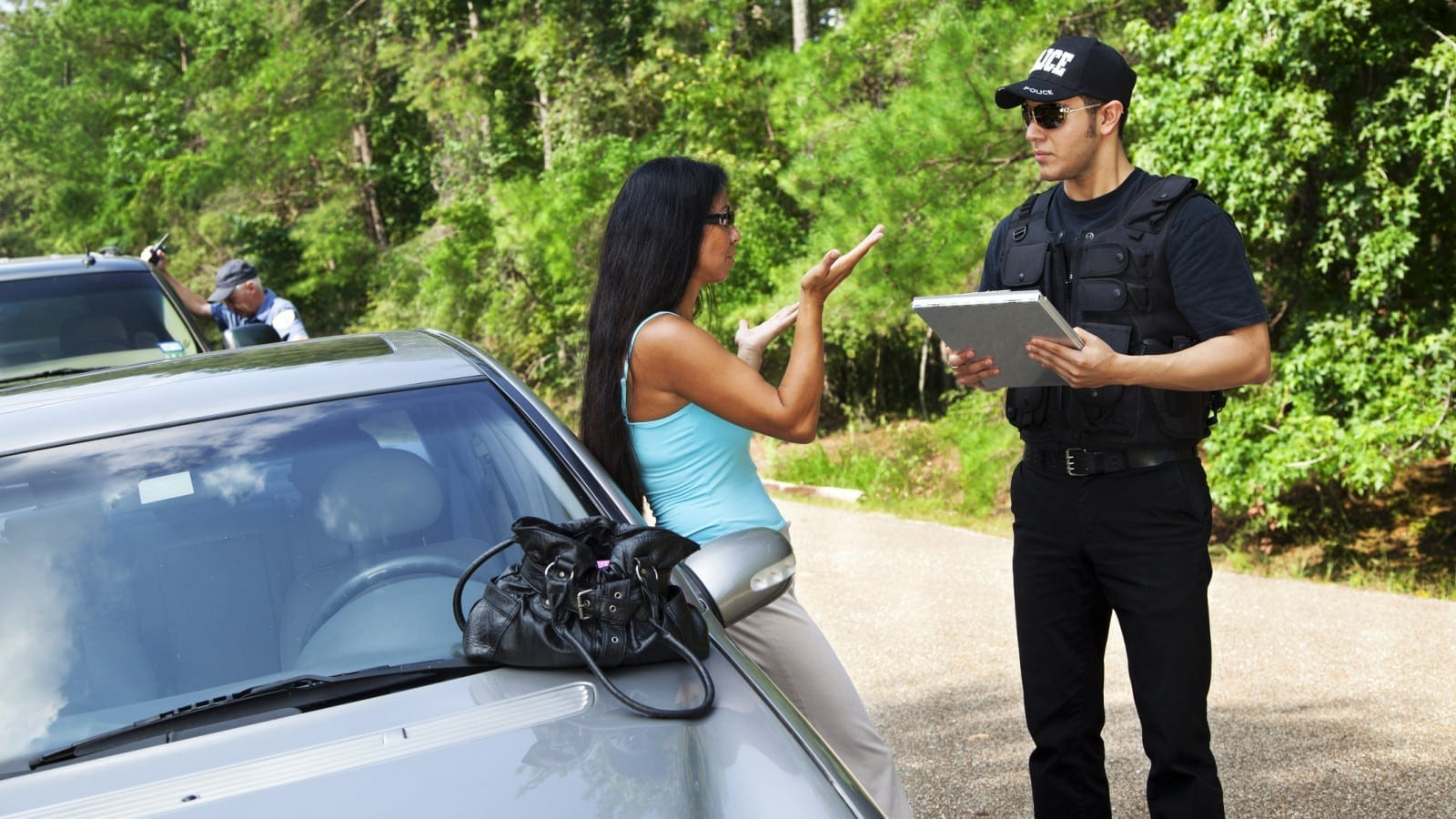 Police Officer Completing Car Accident Report Stock Photo