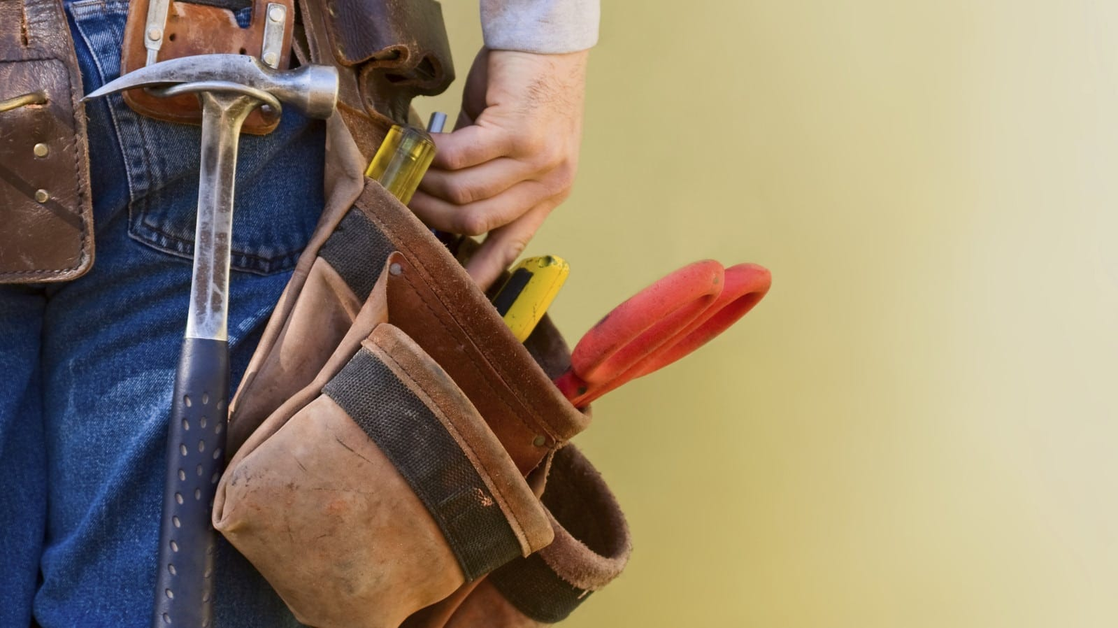 Construction Worker Wearing A Work Belt Stock Photo