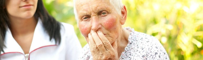 Elderly Woman With Worried Look On Her Face Stock Photo