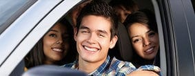 Smiling Teen Drivers In A Vehicle Stock Photo