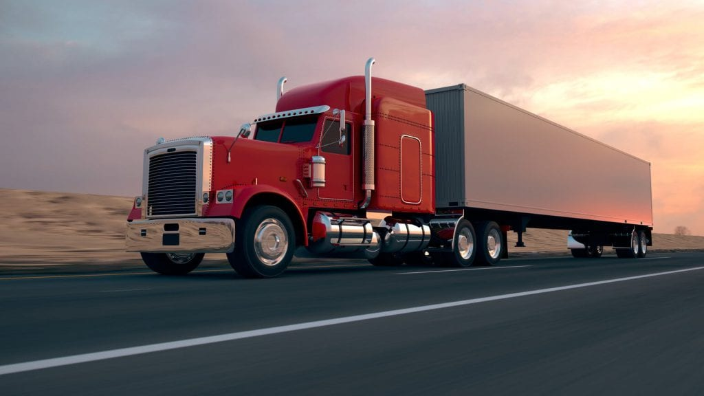 Red 18-wheeler Truck Driving On The Interstate Stock Photo