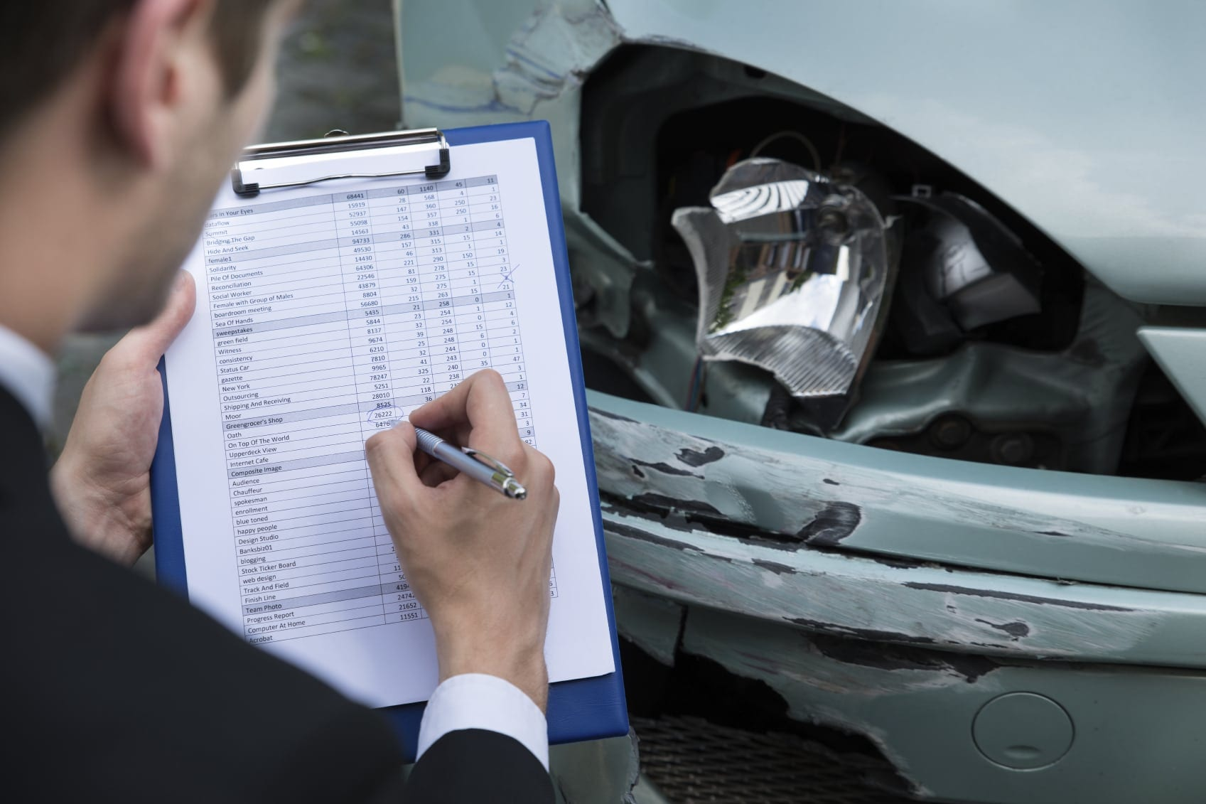 Insurance Adjuster Inspecting Damage To Car Stock Photo