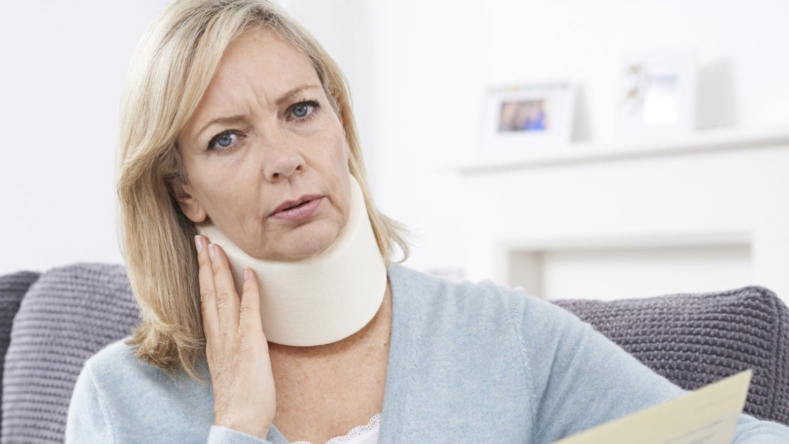 Mature Woman Wearing A Neck Brace Stock Photo