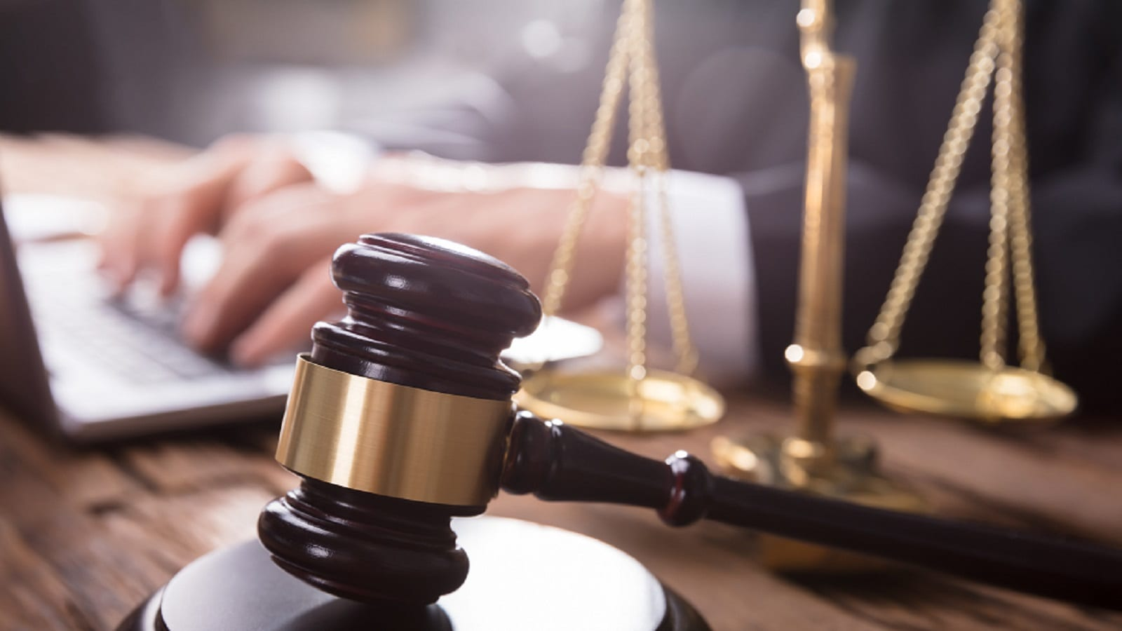 Wood Gavel and Scales of Justice Stock Photo