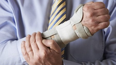 Businessman With Injured Wrist Stock Photo