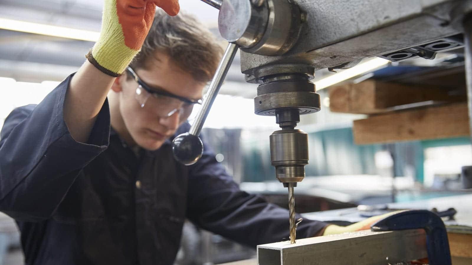 Welder Wearing Protective Eyeglasses Working With Metal