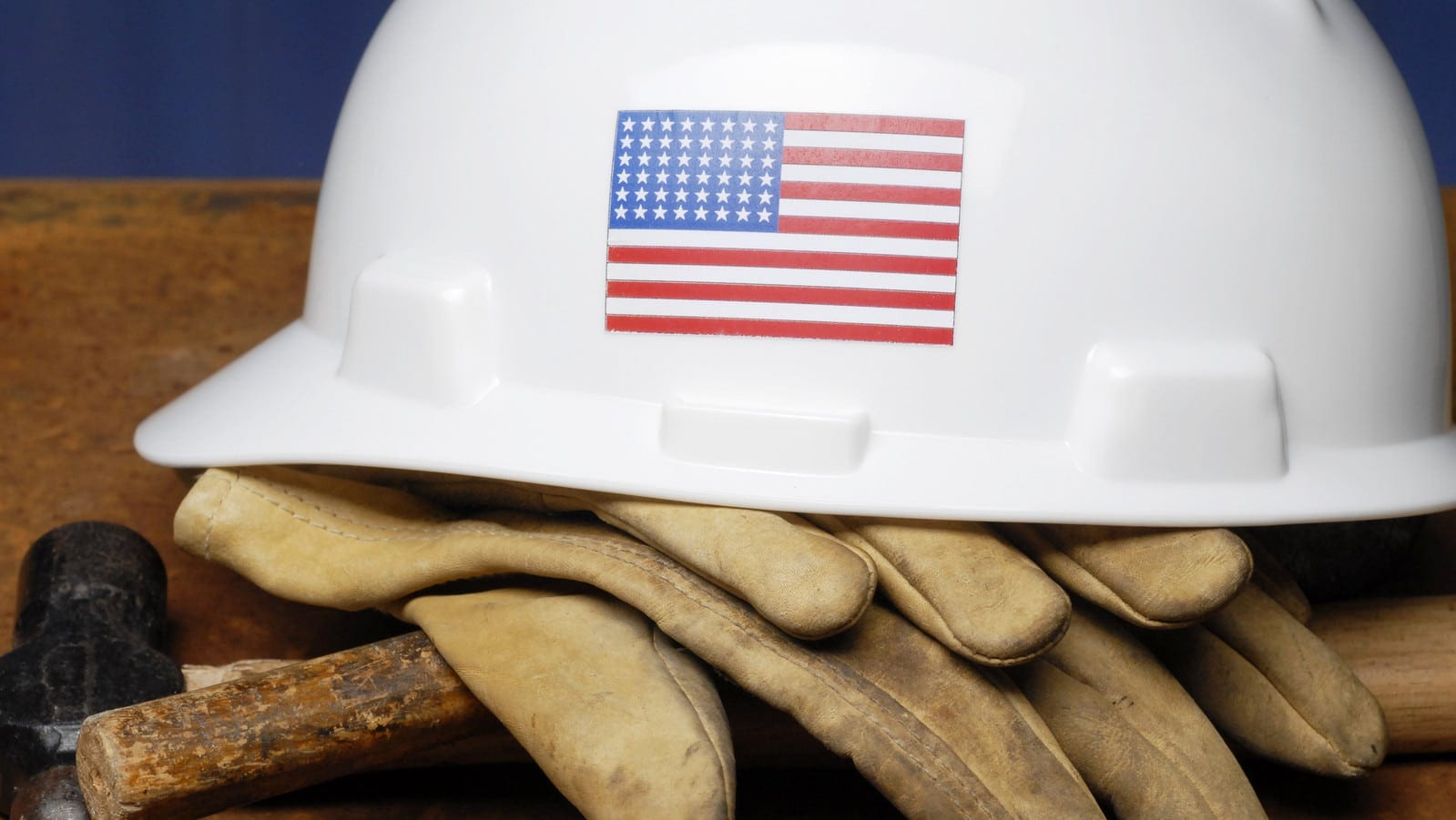 White Hard Hat With American Flag Emblem Stock Photo