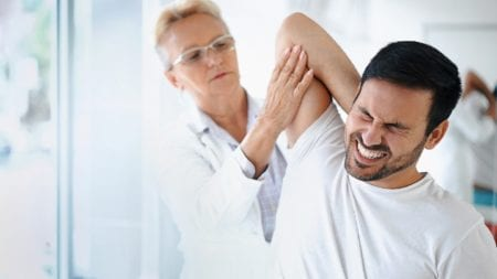 Female Doctor Examining Male Patient Stock Photo
