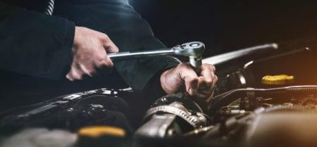 auto-mechanic-working-on-an-engine