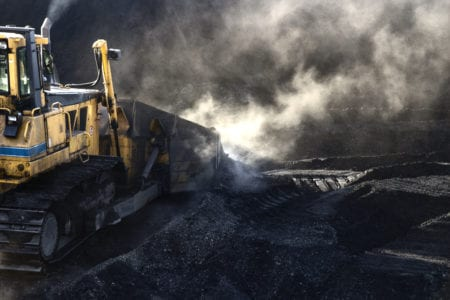 bulldozer pushing coal