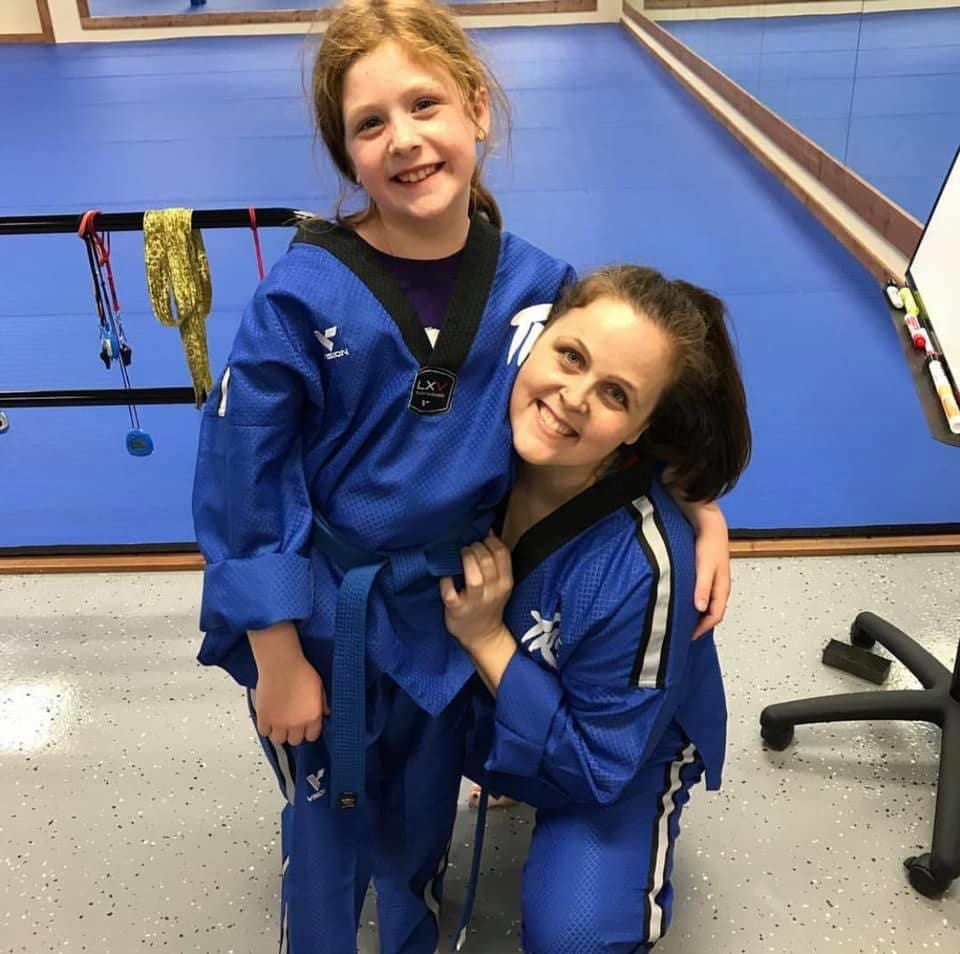 Lea Keller standing with Tae Kwon Do student