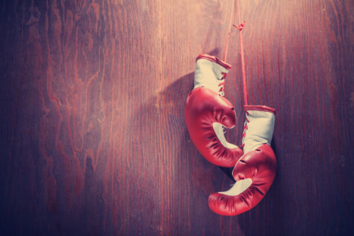 the boxing gloves of Attorney Lea Keller hung up