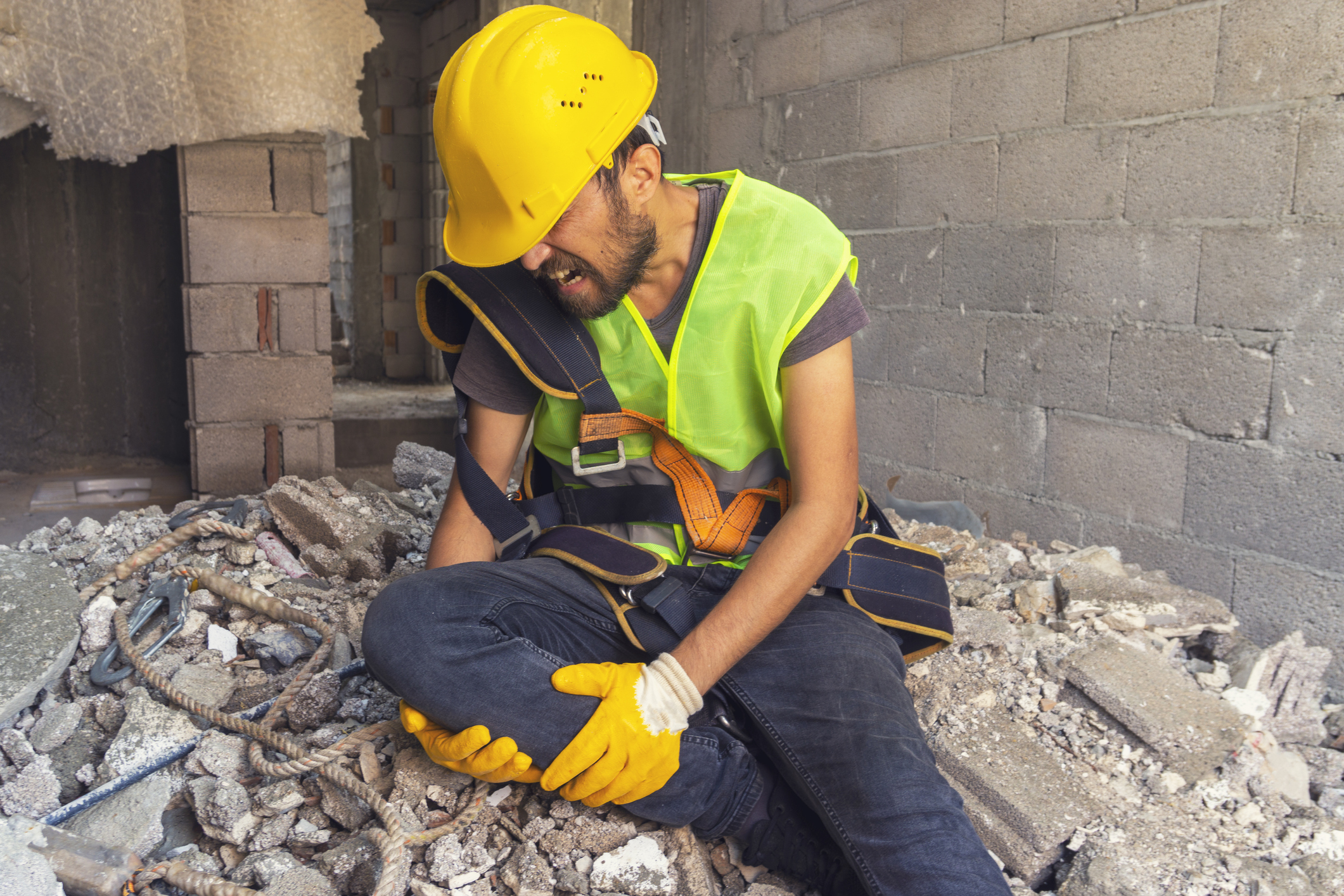 A construction worker suffering an on-the-job injury.